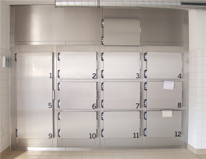 Morgue refrigeration unit with hatches and one big door made of stainless steel