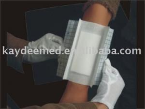 ADHESIVE SURGICAL DRESSING