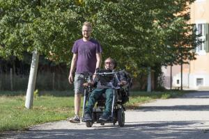 Wheelchair user driving outside with the glasses MyEcc Pupil