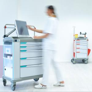 A nurse operates an IT capable hospital trolley: the eWork Cart can be customized with all sorts of devices, screens and accessories