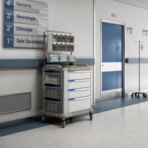 A PRESTO Large multirole hospital trolley in a corridor. The trolley has 4 600mm drawers, lateral tilt-out bins and an accessorized overbridge